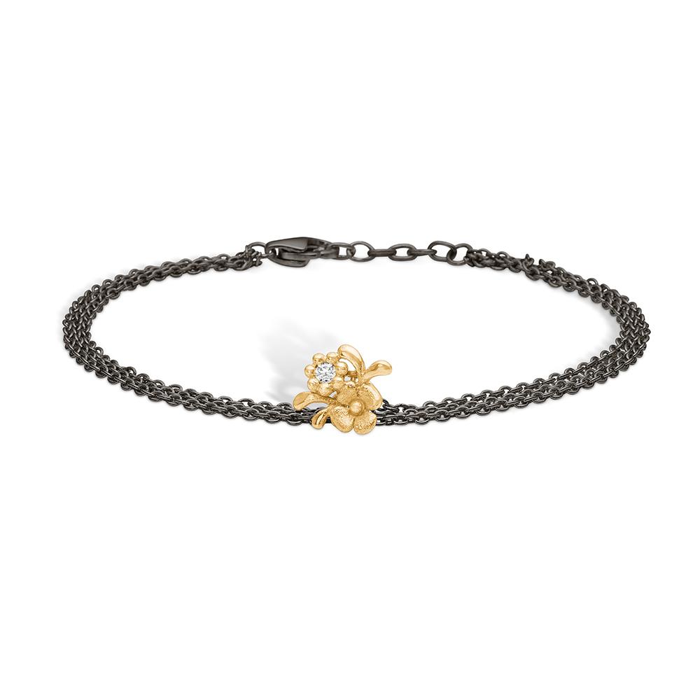 Image of   Blossom sølv sort rhodineret armbånd med 14 kt. blomster, brill 0,03ct, 19 cm