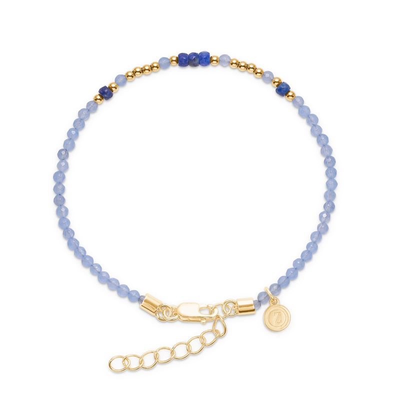 Mads Z Saint Tropez armbånd i forgyldt med et mix af blå ædelsten
