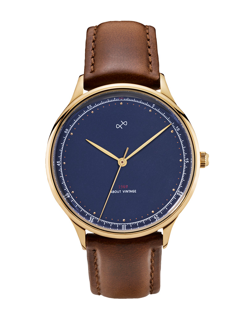 Image of   ABOUT VINTAGE 1969 armbåndsur Ø 36 mm i guldfarvet stål med blå skive og brun læderrem