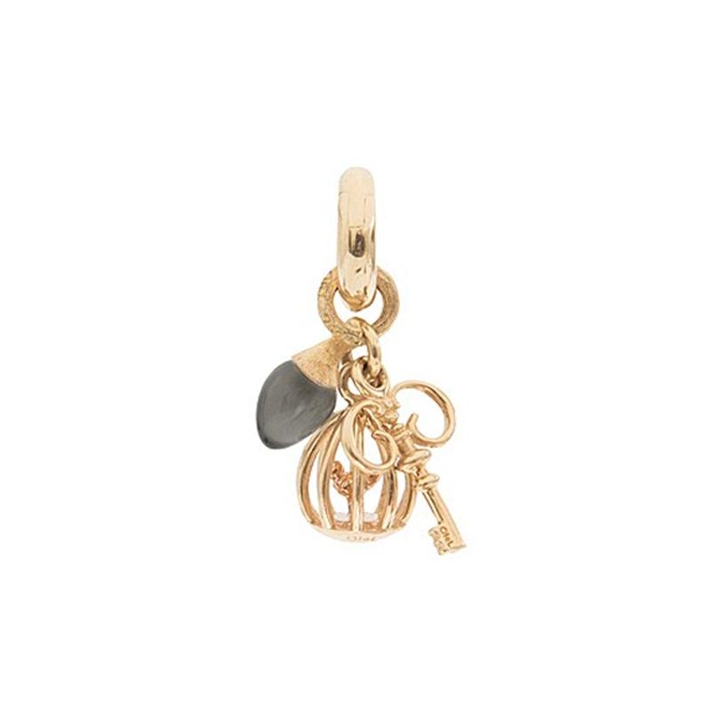 Image of   Ole Lynggaard Charm Sweet Drops Key To Freedom 18 karat rødguld 2 MLW vedhæng, nøgle, fuglebur og vedhæng med grå månesten (opluk)